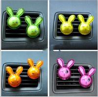 Precio de Car air freshener-Accesorios para el interior del coche Acondicionador de aire del coche Diseño lindo del conejo Aire automático del enchufe Aromatherapy suministra el envío libre