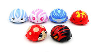 Wholesale classic toy plastic mini pull back model car ladybird beatles style spinning top spin peg top gyro for children Hasbro Beyblades