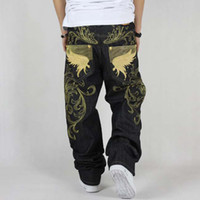 Wholesale Men s fashion hiphop jeans loose plus size embroidery wings denim pants male large size hip hop long trousers