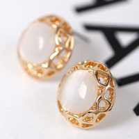 Wholesale Yiwu Korean fashion jewelry trade disc pierced earrings opal earrings jewelry mixed batch of female accessories