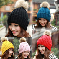 Wholesale Unisex high quality Solid color roll up hem knitted hat raccoon fur wool ball knitted hat warm autumn and winter women s hat