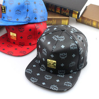 Wholesale 2014 retail new leather mcm letter mc iron standard flat brimmed cap fashion hip hop baseball hat brand crown snapback for women men