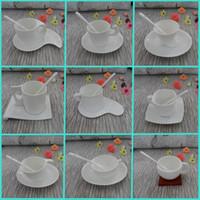 Wholesale European white bone china coffee mugs and creative ceramic tea cup set including cup saucer spoon