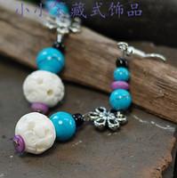 Wholesale Tibetan jewelry bone carving color bead earrings