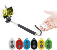 Wholesale SMART Bluetooth Remote shutter Selfie Portable Handheld Self timer Monopod with phone holder For IOS and andriod