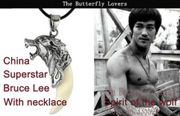 Wholesale 2014 Material titanium steel necklace pendant inlaid dogs teeth shape necklace with Bruce Lee