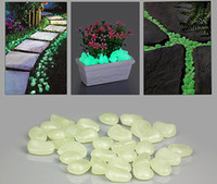 Cheap 50pcs pack artificial Glowing stones Photoluminescent pebbles for garden pave,aquarium decoration