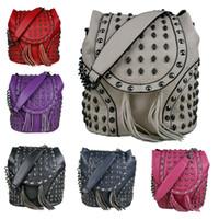 barrel satchel - New Fashion Lady Designer PU Leather Skull Rivet Backpack Women Tassel Barrel shaped Cross body Satchel Shoulder Bag L1414