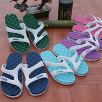 Wholesale women and men home eva beach slippers women s men s lovers casual massage plastic sandals indoor slippers