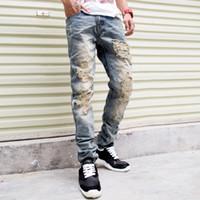 designer casual jeans - New Famous Brand Vintage Men designer Casual Hole Ripped Jeans Mens Fashion Skinny Denim Pants Silm Fit Male Trou