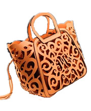 cutout carved handbag