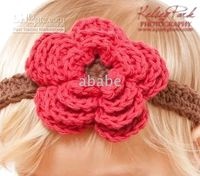 Crochet baby girl headband with a four- petal flower 100% cot...