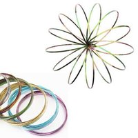 Colorful Rainbow Magic Flow Ring Metal Amazing Toys Kinetic ...