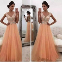 New Crystals Beaded Peach Prom Dresses 2018 A Line V Neck Lo...