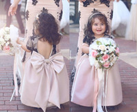 Wholesale short sleeve open back wedding dress online - Cute Blush Pink Baby Pageant Gowns With Black Lace Appliques Open Back Short Sleeve Flower Girl Dresses Big Bow Children Communion Dress