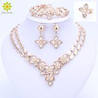 Wholesale 18k bracelet dubai online - Flower Pendant Jewelry Sets For Women Necklace Earrings Bracelet Ring Gold Plated Africa Dubai Party Wedding Bridal Accessories