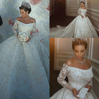 Wholesale long sexy wedding dresses online - Luxury Dubai Wedding Dresses Off The Shoulder Sparkly Beading Appliques Bridal Gowns Sheer Long Sleeves Saudi Arabia Wedding Vestidos