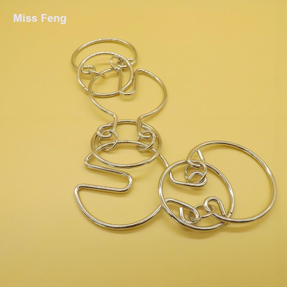 Juegos de magia china Comer anillo de frijol Rompecabezas Alambre Metal Cerebro Juguetes