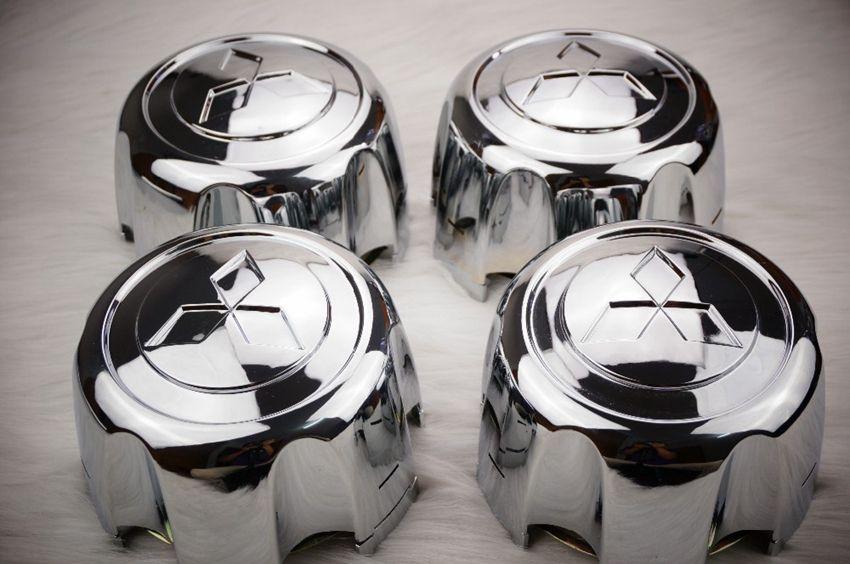 4pcs / lot MB816581,92-04 MITSUBISHI MONTERO Casquillo del centro del cubo de la rueda deportiva NUEVO Shogun, Pajero, Challenger, Delia, L200, L400 110 mm