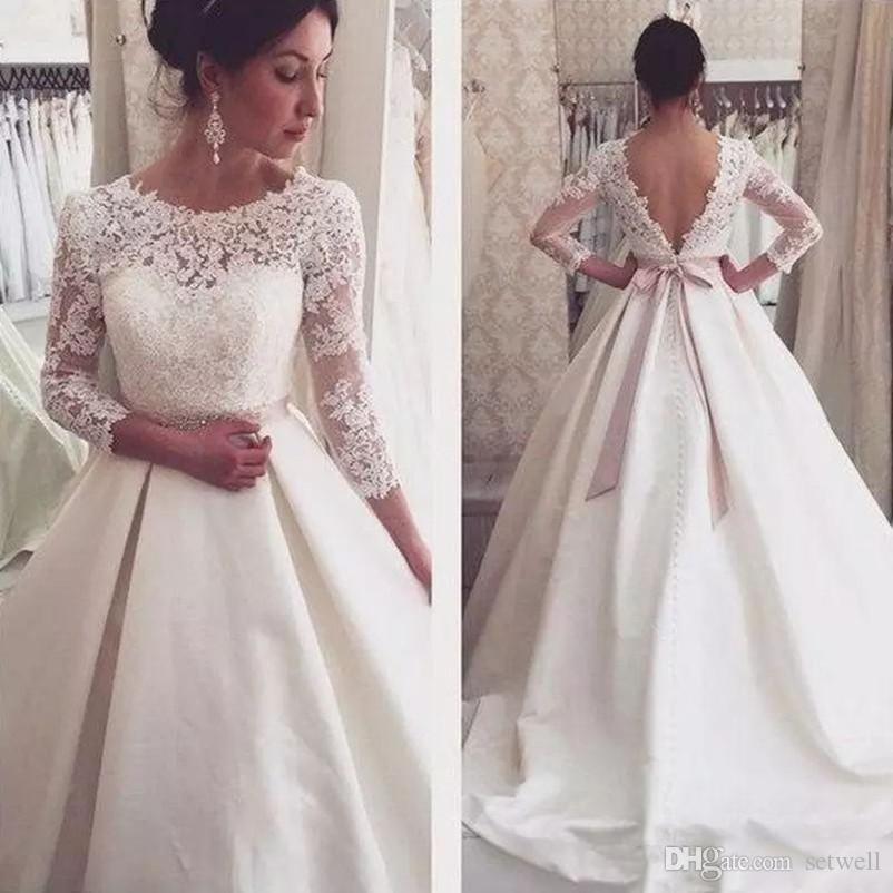 Robes de mariée robe de bal Vintage dentelle Top Appliqued manches longues robes de mariée dos nu robes de mariée pays jardin