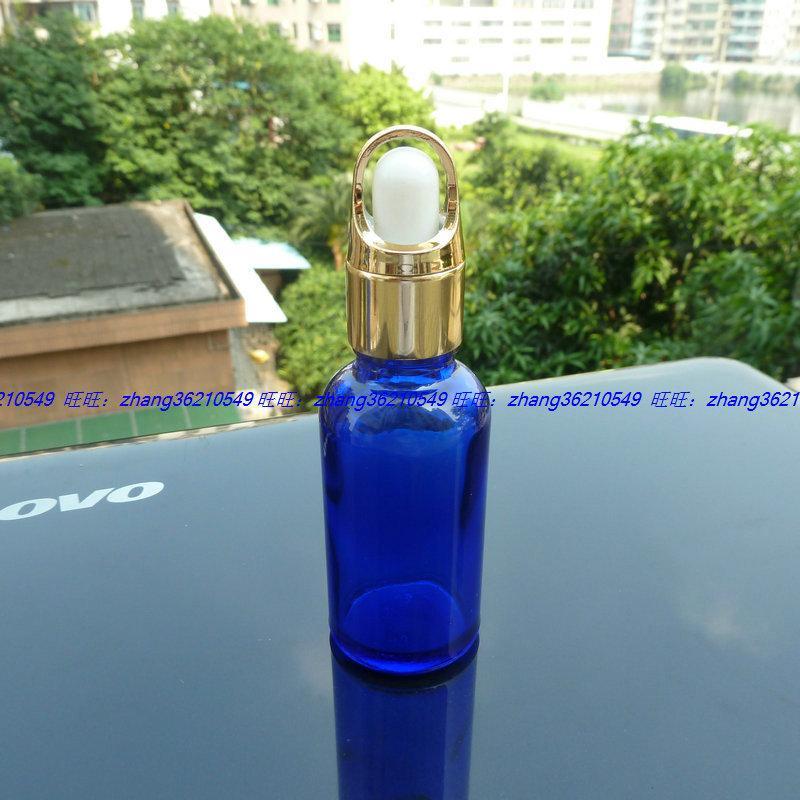 30ml 블루 글라스 에센셜 오일 병 반짝이는 골드 스포이드 캡이 달린 알루미늄 바구니. 오일 바이알, 에센셜 오일 용기