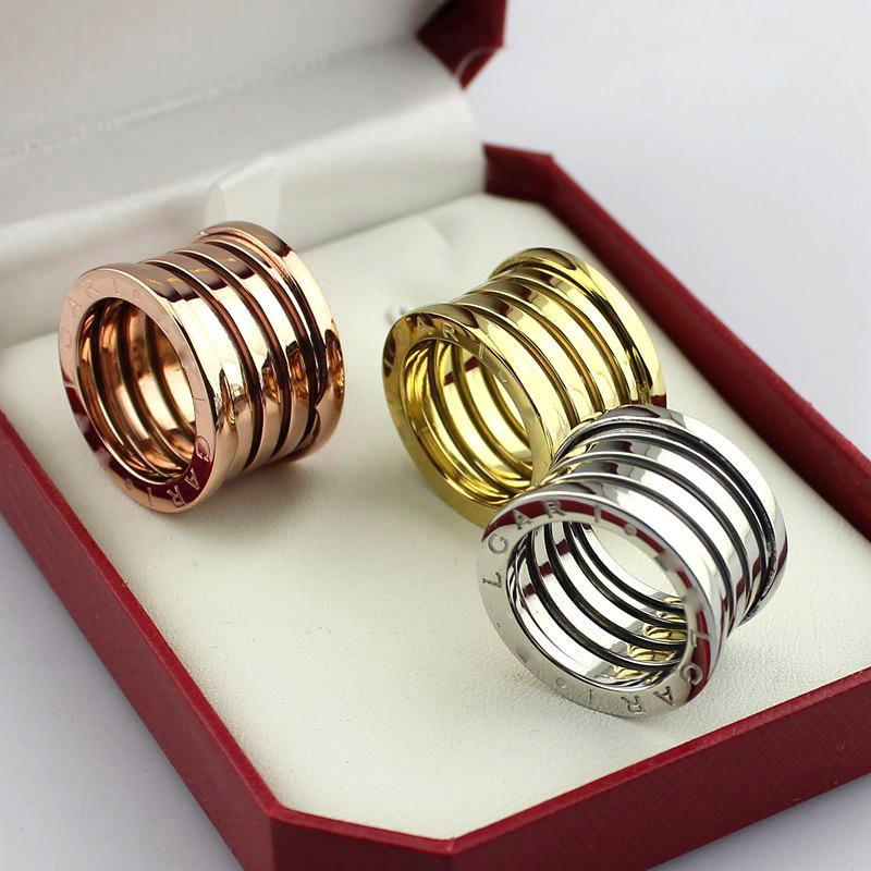 Venta caliente de calidad superior anillo de primavera para mujer hombres joyería 18 K oro rosa titanio acero versión ancha regalo
