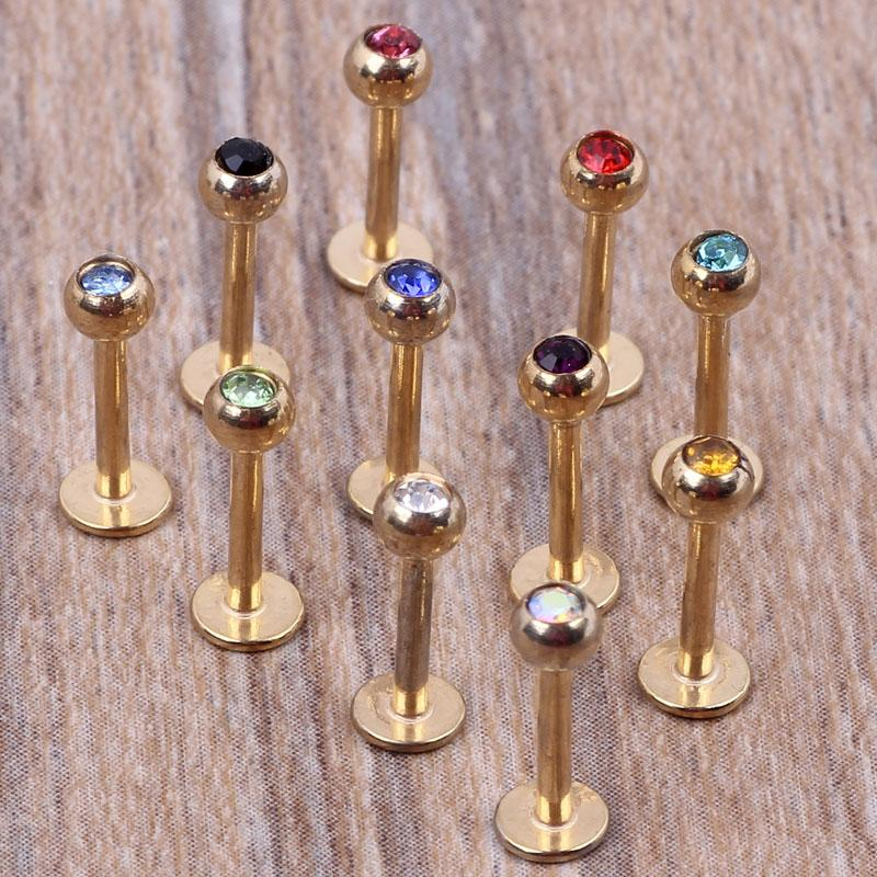 Guld läppstång 100st / lot mix 7 färger stålkropp smycken piercing läppring labret