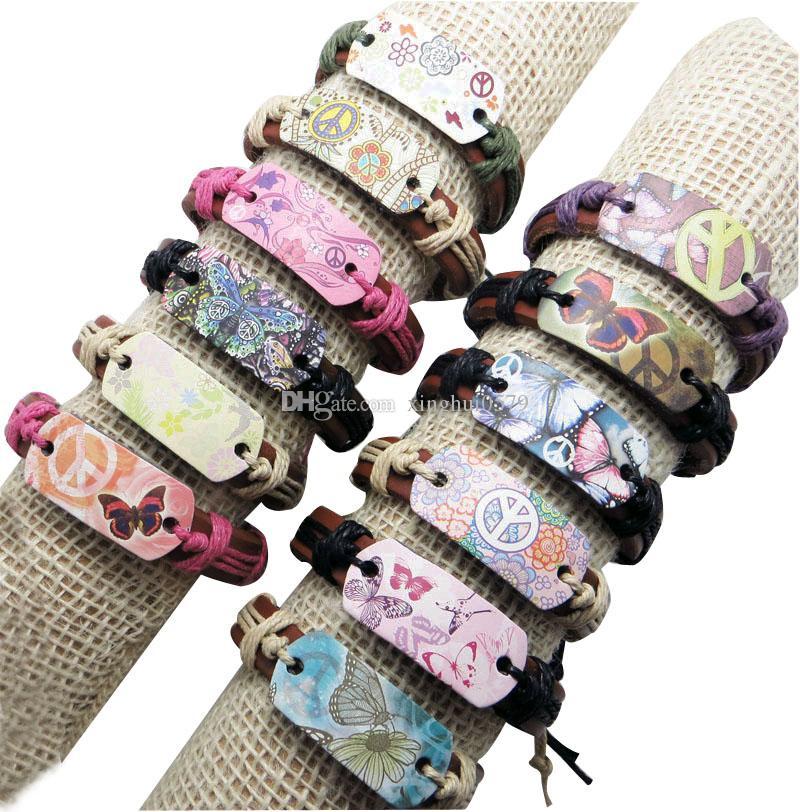 il braccialetto di cuoio 12pcs / lot mescola il modello all'ingrosso libero che spedice il braccialetto di pace della farfalla del braccialetto del braccialetto di stile della corda di cuoio di molti colori