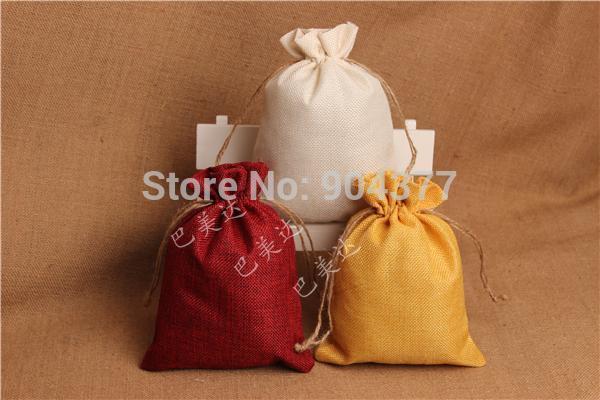 Bolsas de empaquetado de literas de yute de color puro Bolsas de almacenamiento de tela de lienzo con cordón reutilizable grande 13 * 19 CM 10pcs / lot color de mezcla gratis