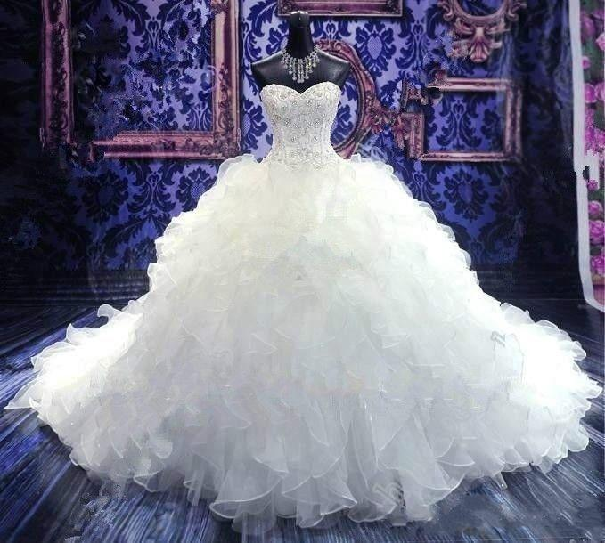 2021 Bordado con cuentas de lujo Vestidos de bola Vestidos de novia Princesa Vestido Corsé Sweetheart Organza Ruffles Catedral Tren Barato barato