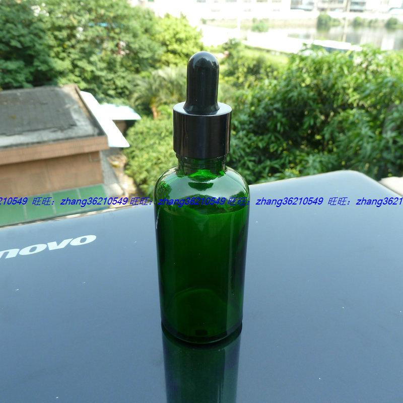 50ml 녹색 유리 에센셜 오일 병 반짝이는 검은 점이 떨어지는 알루미늄 캡. 오일 바이알, 에센셜 오일 용기