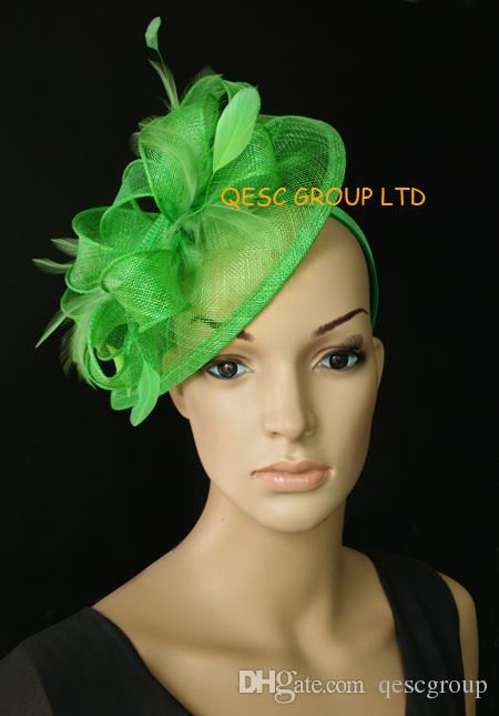Mini green sinamay fascinator hat with feathers for races,wedding and party.
