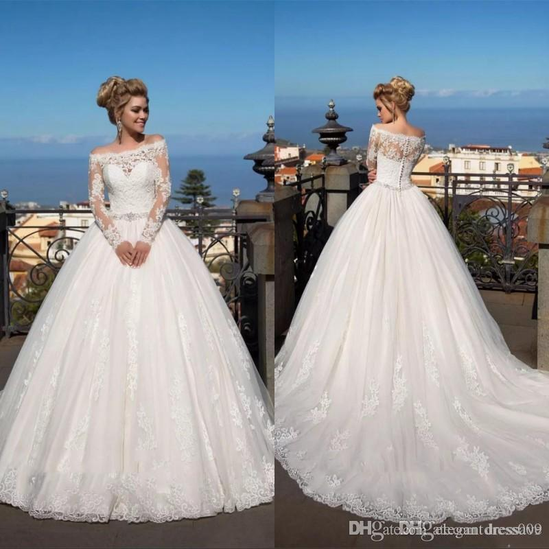 Modeste manches longues A-ligne Robes de mariée en dentelle longueur de plancher de perles appliques en cristal Jupettes Robe de mariée Robes de mariée Robes De Mariage