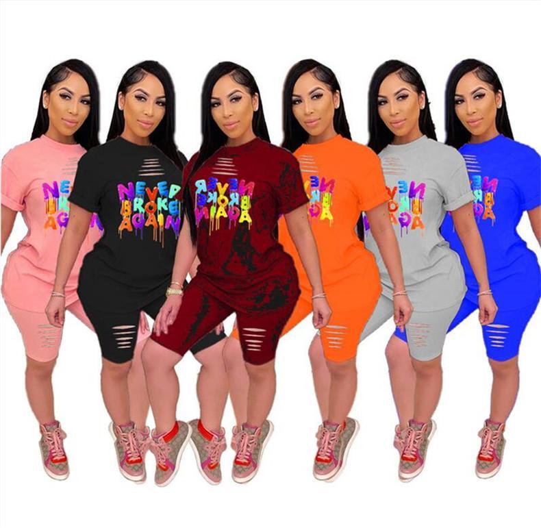 2020 النساء ملابس المصممين قصيرة الأكمام المحملة أعلى + السراويل رياضية إلكتروني طباعة ممزق ثقوب 2 قطعة مجموعات الملابس الرياضية S-5XL D52205LY