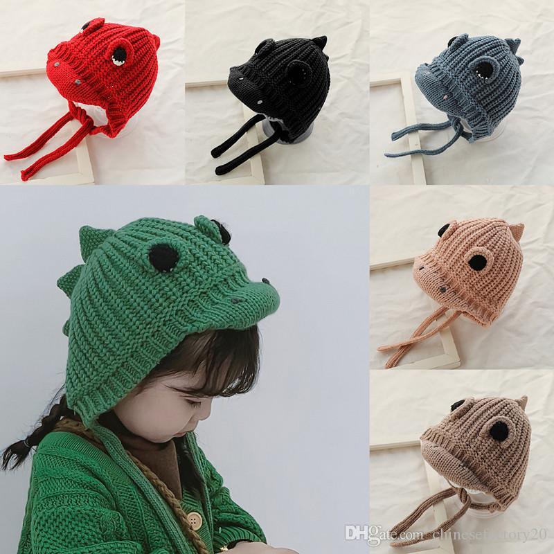 طفل بنات أولاد قبعة الشتاء الديناصور حك دافئ لينة طفل قبعة صغيرة للطفل Earmuff وقبعات كروشيه جديد 8 ألوان