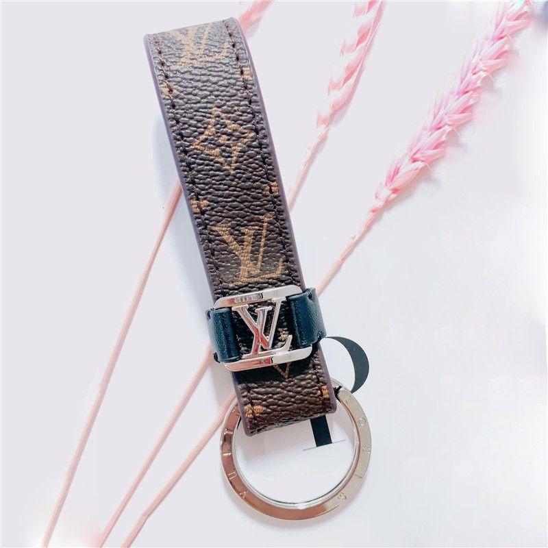 De lujo del cuero genuino cadena dominante del coche de impresión Carta llavero como regalo de la manera Accesorios Llave de la Puerta del anillo clave