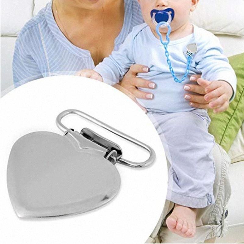 Succhietto morsetto Baby Care Bretelle Ferro lattante Cuore Holder Forma Ciuccio bretella clip di alimentazione di accessori con i capezzoli TqWH #