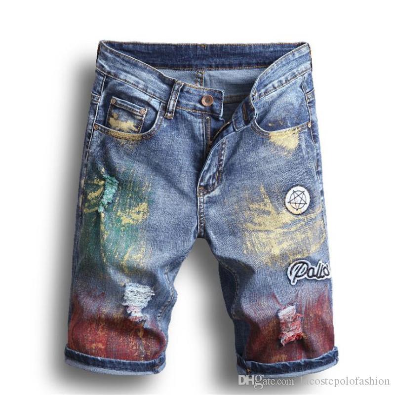 Diseñador para hombre Jeans bordados Pantalones cortos Agujeros de moda Pantalones de lápiz delgado Homme Spray Paint Zipper Fly Pantalones