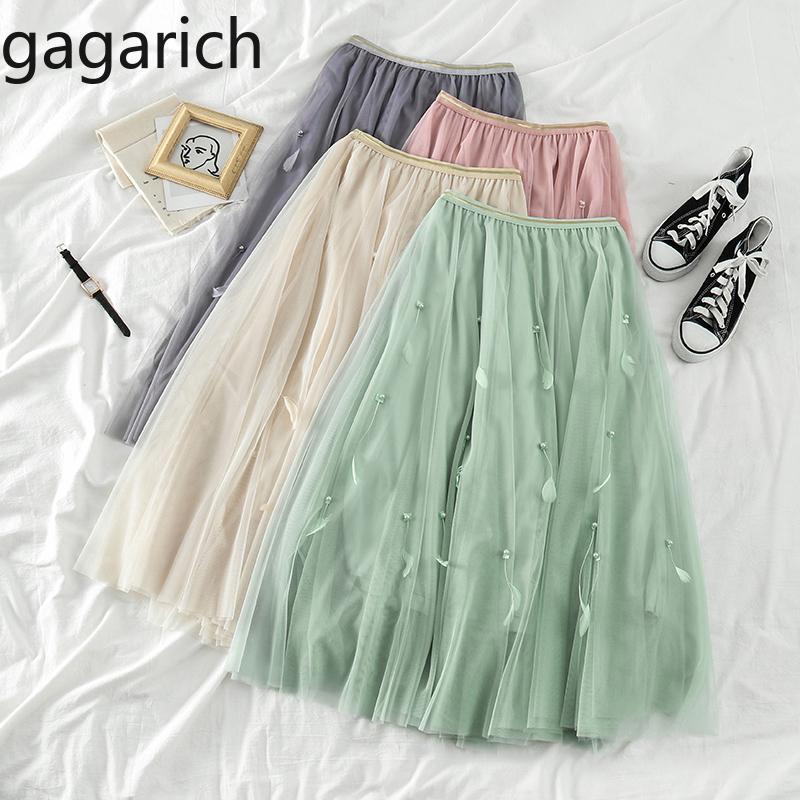 Donne Gonne Mesh dolci Gagarich 2020 signore della molla calda di alta vita sottile mezza lunghezza gonna femminile di moda perline Jupe Chic