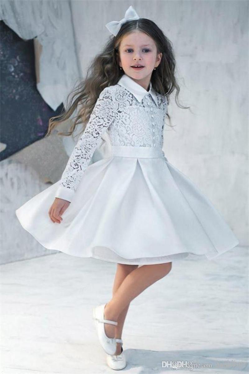 2018 New Nely nette weiße A-Line Flower Girl Kleid-süße Knie-Länge hohe Ansatz-Geburtstags-Party-Kleid mit langen Ärmeln Knopf Spitze-Partei-Vestido