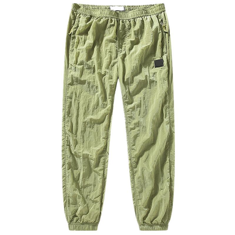 TopStonee Konng Gonng Весна и осень Новый стиль металлические нейлоновые мужские спортивные брюки леггинсы модные брюки брюки