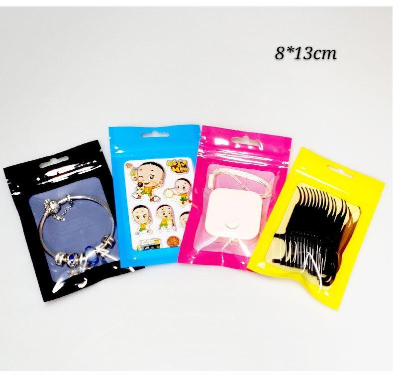 100pcs Diverses couleurs 8 * 13 cm Feuille d'aluminium Mylar Emballage Sacs Effacer la fenêtre à l'avant, Sac de rangement alimentaire à fermeture zippée brillante avec Notch déchirant