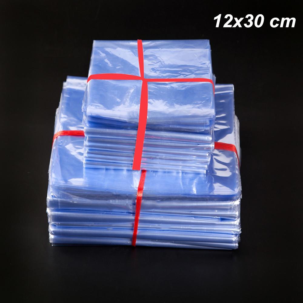 200 pçslote 12x30 cm Poli PVC Plástico Filme Shrinkable Envoltório de Calor Saco de Embalagem de Alimentos Cosméticos para o Vinho Encolher Dissipadores De Calor De Armazenamento Transparente