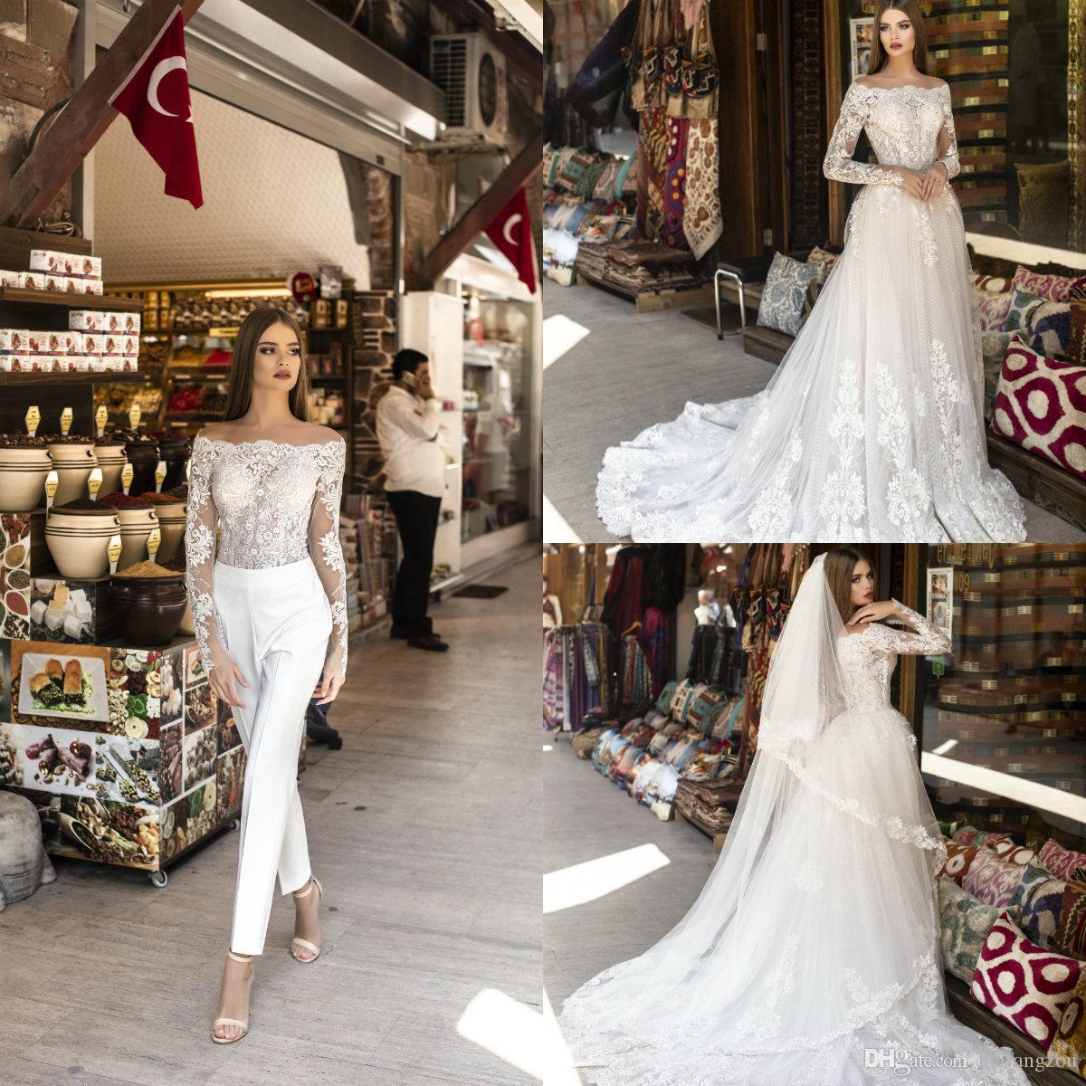 Mono de boda elegante 2020 con sobrefaldas desmontables Vestido de novia de playa de tren de barrido de línea Apliques de encaje Batas largas baratas de Mariée