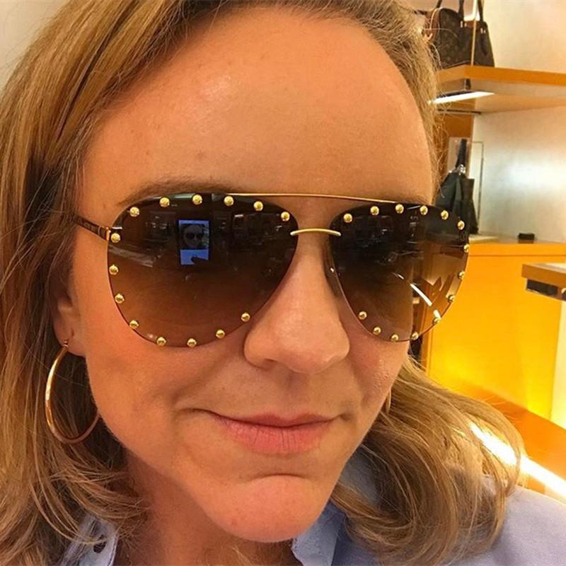 Venta al por mayor sin montura piloto Modis gafas de sol Oculos mujeres hombres diseñador de la marca de lujo 2019 Retro gafas de sol Shades Festival regalo UV400