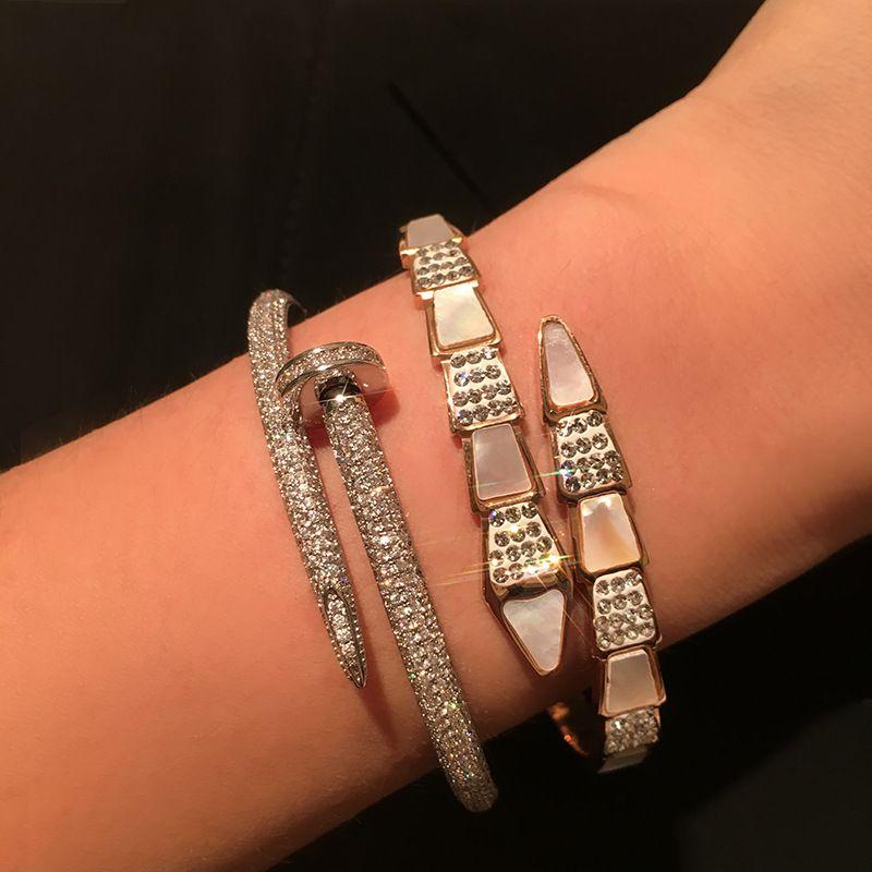 titane acier or rose bracelet serpent coquille naturelle femme bijoux design bracelet design bracelets femmes bijoux design de luxe