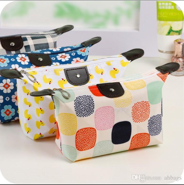 Sac cosmétique portable en forme de boulette Wrap Sac de lavage Sac pour femme Mini poche Portable Pack Voyage reçoit des sacs de gargarisme Multifonctionnel Tra