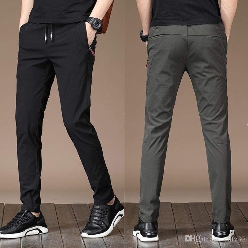 erkek tasarımcı Kış üst seviye rahat pantolon erkek gençlik ince düz streç çabuk kuruyan pantolon erkek öğrenci pantolon