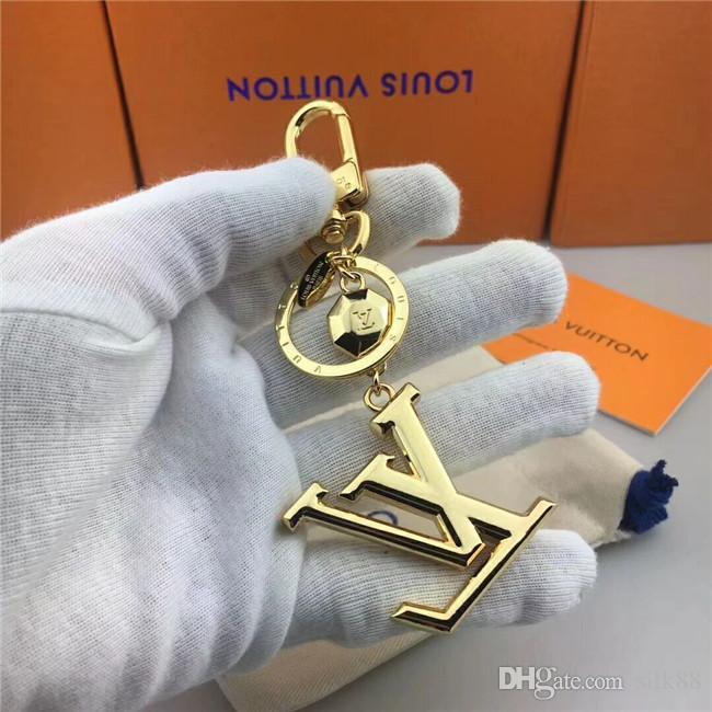 Paquete de caja de regalo de cadena de llavero de marca de metal de lujo de alta calidad para hombre y mujer