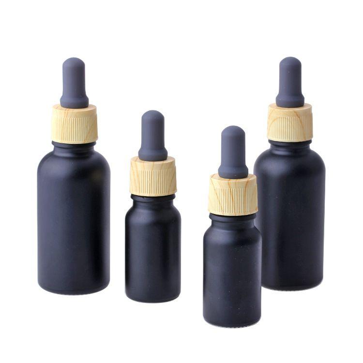 ماتي الأسود دخان النفط ه زجاجات السائل الزجاج الضروري النفط زجاجة عطر السائل الكاشف زجاجات القطارة ماصة مع الخشب الحبوب كاب 10/30 مل